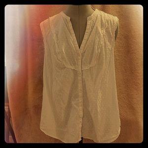 White sleeveless v-neck button up